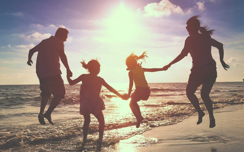 Family on the beach with Travel Perks